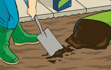 A person using Irish Moss peat as a top dressing on a piece of soil intended for lawn seed.