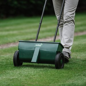 lawn drop spreader in use