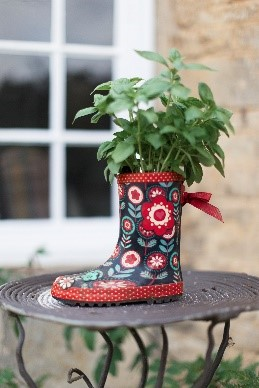 flowers planted in wellington boots display