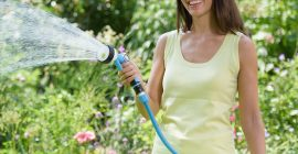 lady watering with spray gun