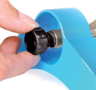 pulling out nozzle cleaning tool from sprinkler