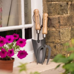 Carbon Steel Hand Fork and Trowel on window ledge