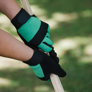 green flex protect gloves on tool