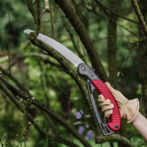 folding saw with hand guard in use
