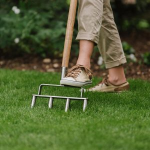 kent & stowe stainless steel lawn aerator in use