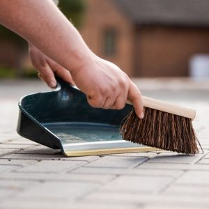 dustpan and brush in use